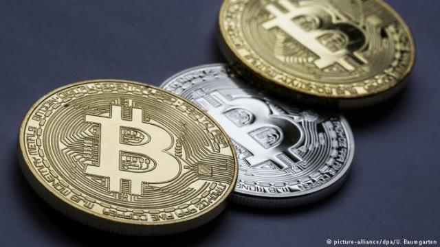Криптовалюта биткоин - безопасная гавань или спекулятивный пузырь?
